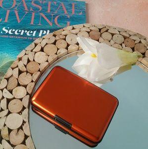 Handbags - **Orange Metal Safety Clasp Wallet**